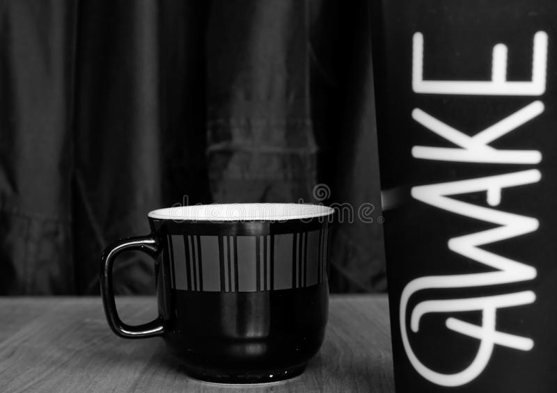 Coffee cup. Black and white coffee cup on a table stock photos