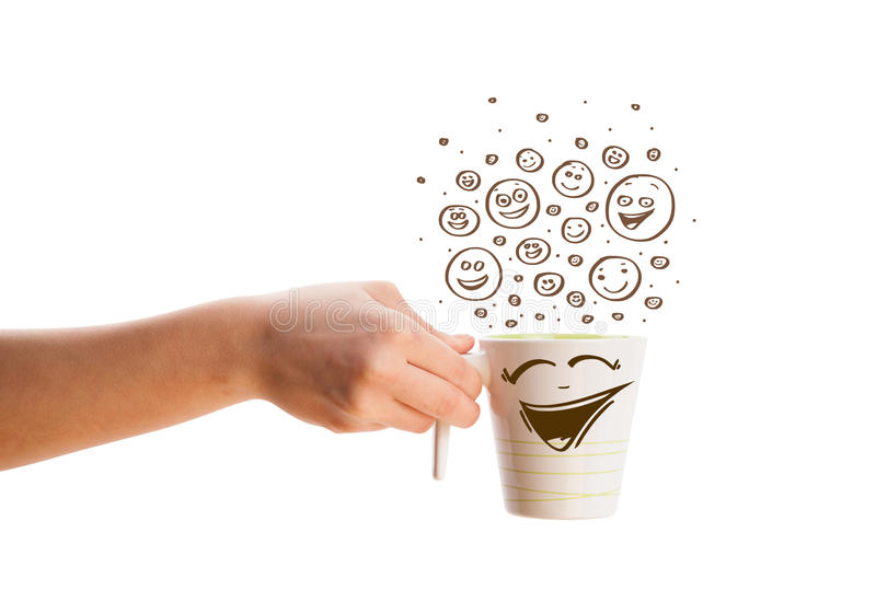 Coffee-cup with brown hand drawn happy smiley faces. Isolated on white royalty free stock images
