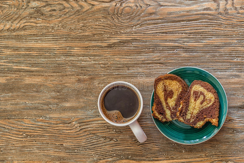 Coffee cup with a cake on wooden background. royalty free stock photo