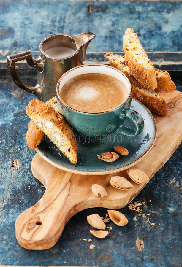 Coffee cup and cantucci. On blue background royalty free stock images