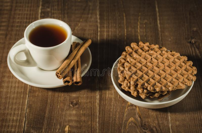 coffee cup with cinnamon and chocolate cookies/coffee cup with cinnamon and chocolate cookies on a wooden background. Top view royalty free stock image