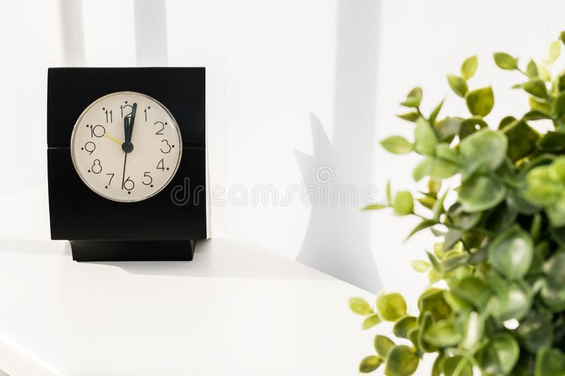 Coffee Cup with clock on white background. It`s time for a coffee break royalty free stock image