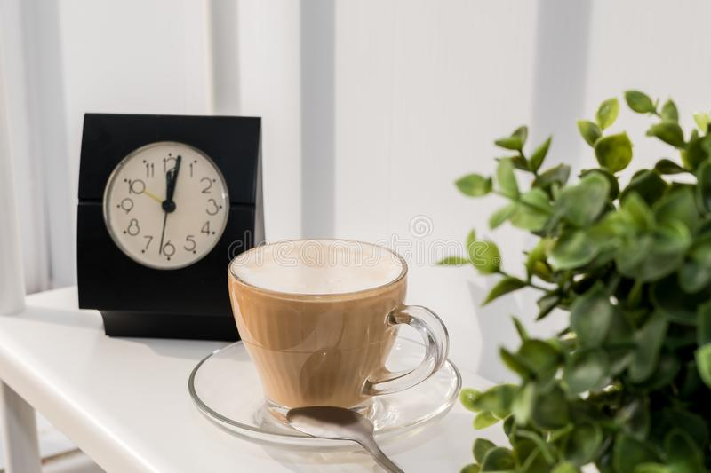 Coffee Cup with clock on white background. It`s time for a coffee break stock images