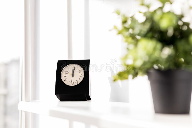 Coffee Cup with clock on white background. It`s time for a coffee break stock photography