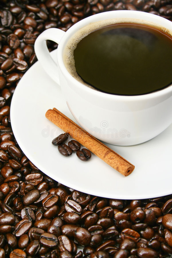 Free Coffee Cup Close-up Over Coffee Beans Royalty Free Stock Image - 4871136