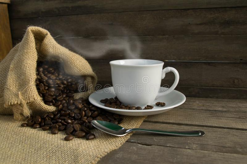 Coffee cup, coffee beans royalty free stock photos