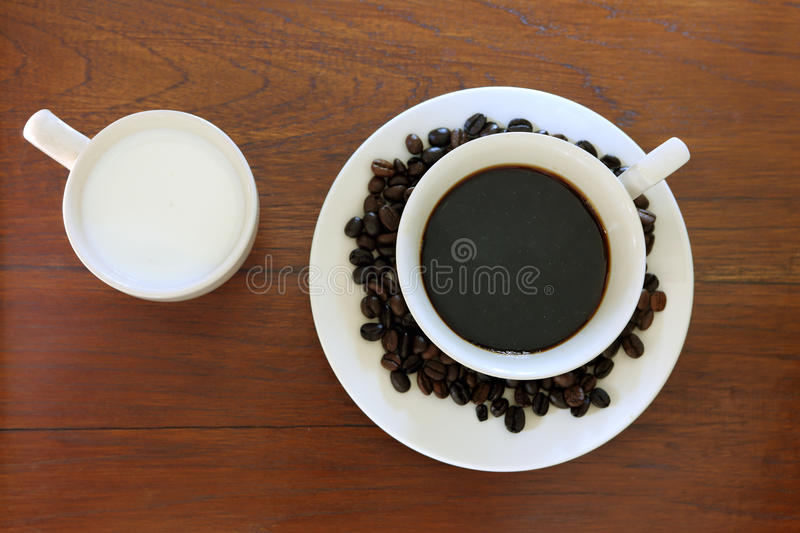 Coffee cup with Coffee Beans and milk on grunge wo. Od royalty free stock photos