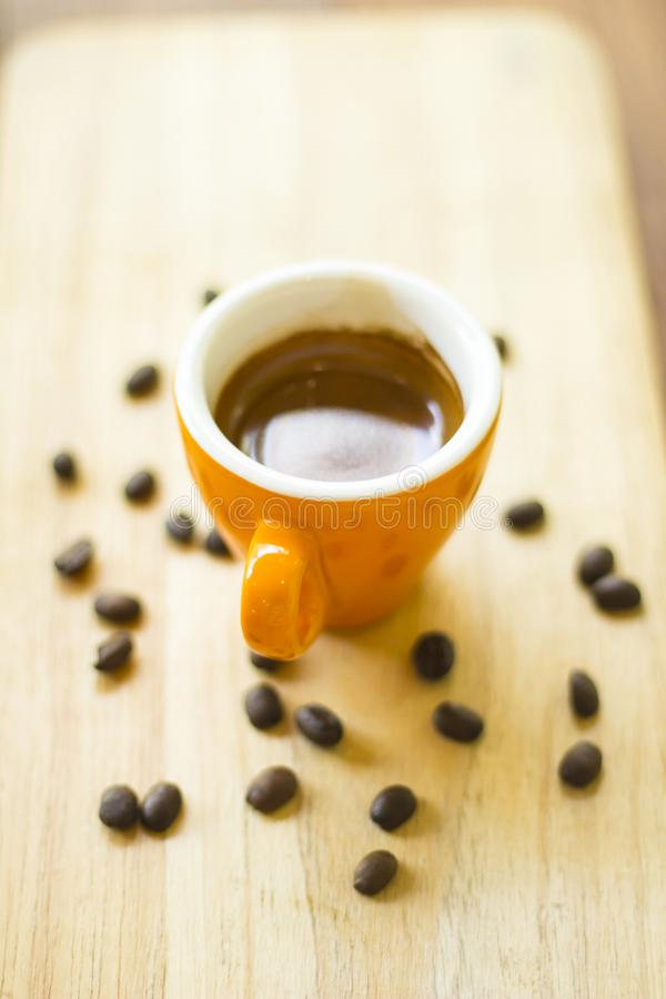 Coffee cup and coffee beans on wood royalty free stock photo