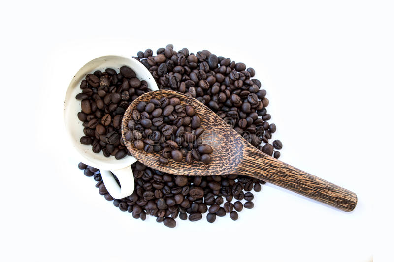 Coffee cup and coffee beans on wood spoon. Isolate on white background stock images