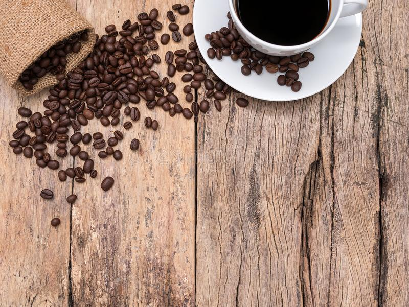 Coffee cup and coffee beans on wooden background with copy space stock photo