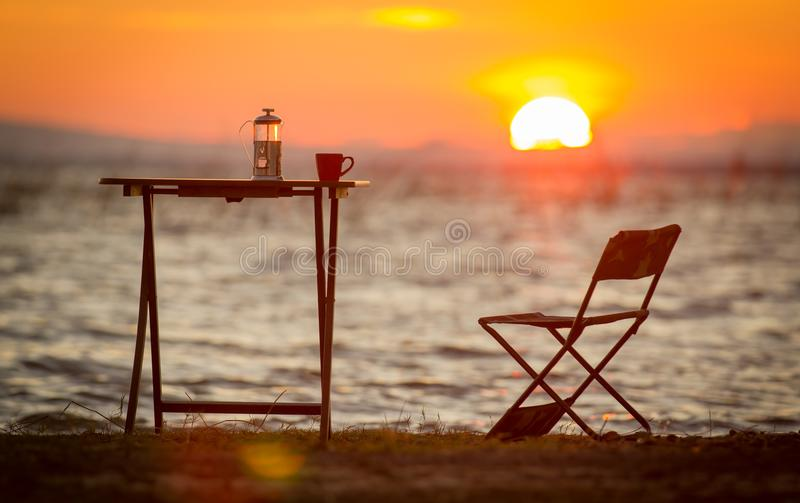 Download Coffee Cup And Coffee Maker On Table With Sunset Or Sunrise Back Stock Photo - & Coffee Cup And Coffee Maker On Table With Sunset Or Sunrise Back ...