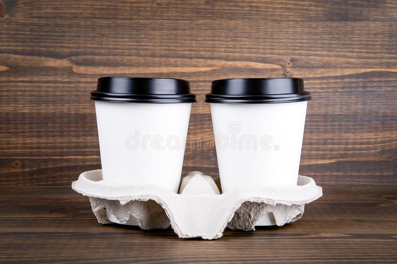 Coffee cup with copy space on a wooden background royalty free stock images