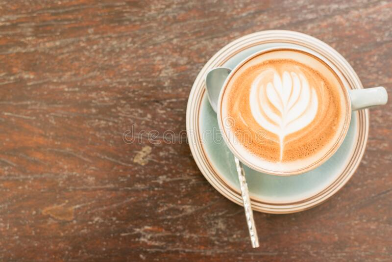 Coffee cup with decorative foam royalty free stock image