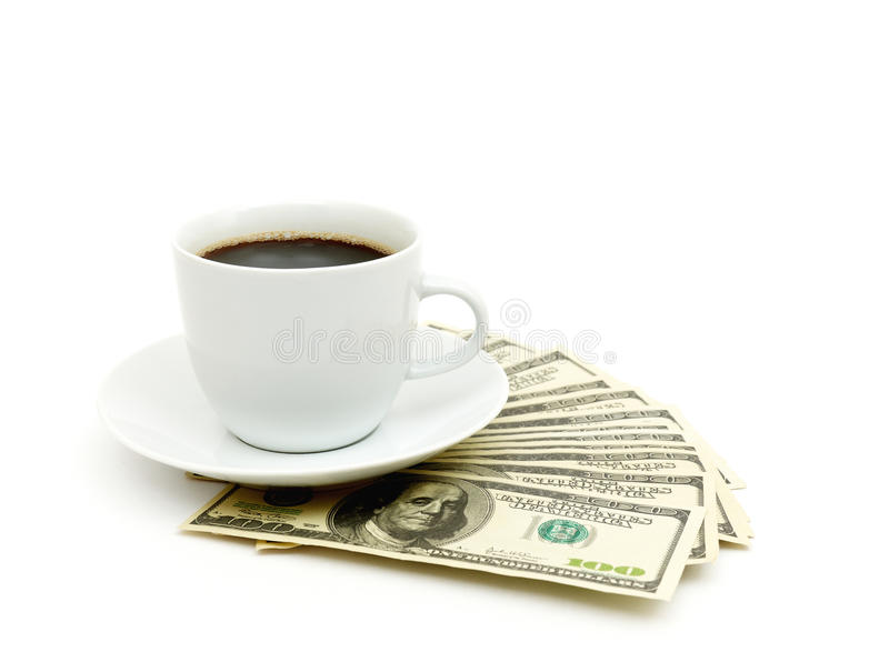 Coffee cup and dollar close up stock images