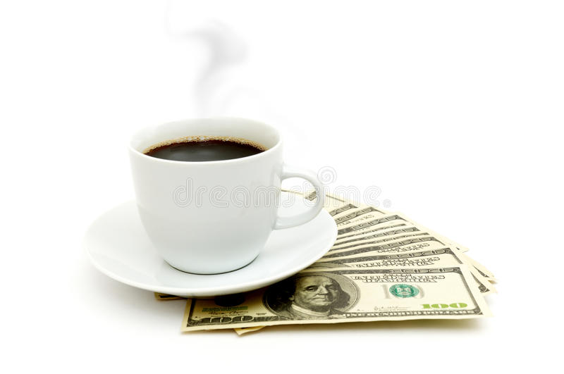 Coffee cup and dollar close up stock photo