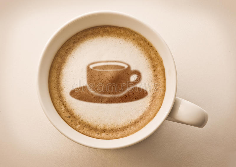 Coffee cup drawing in coffee cup. Coffee cup latte art drawing on coffee foam royalty free stock photography
