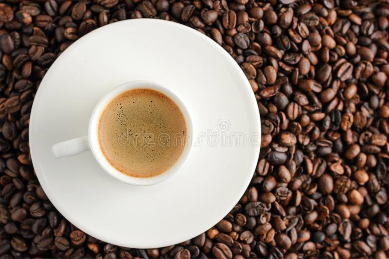 coffee cup espresso on coffee beans backgroun. top view stock images