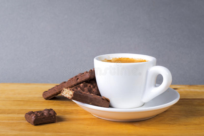 Coffee cup with espresso and chocolate cookies. Coffee cup with espresso and small chocolate cookies royalty free stock photography