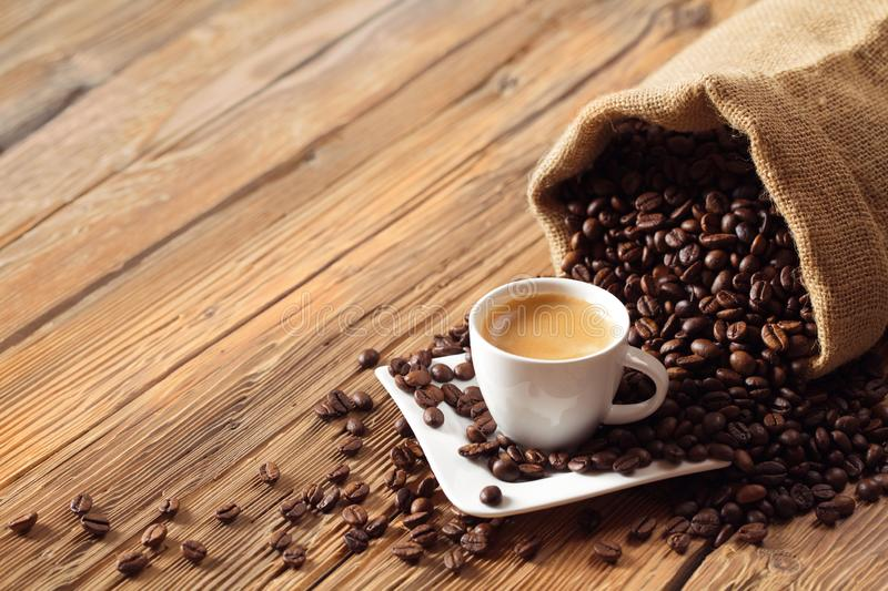 Coffee cup espresso with coffee beans and wooden background. Photo stock images