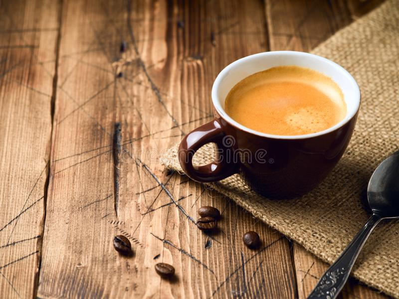 Coffee cup espresso. Over rustic wooden background royalty free stock image
