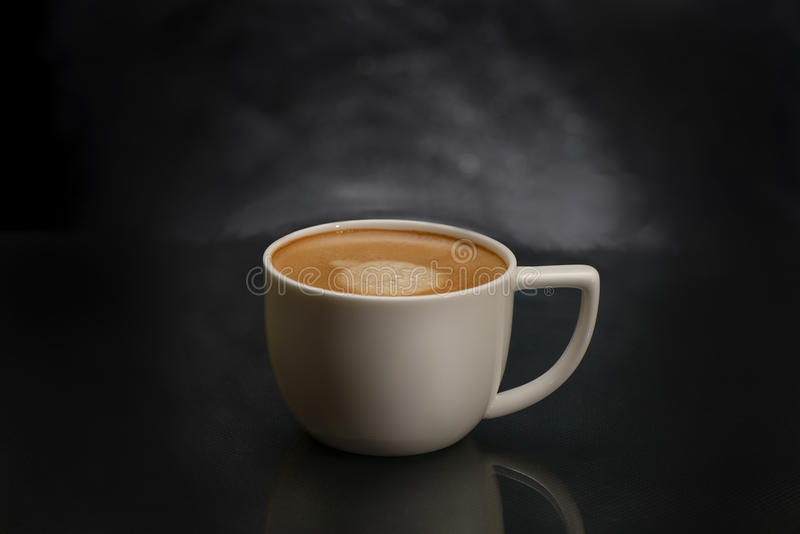 Coffee cup with espresso coffee. On dark background royalty free stock image
