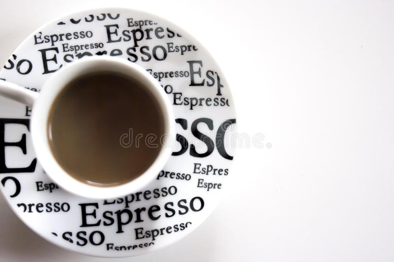 Coffee cup with espresso inscription on white background. White cup of coffee and espresso text. Space for text stock photo