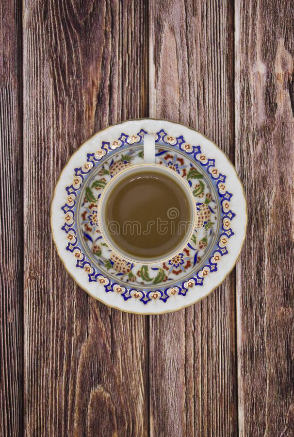 Coffee cup espresso and poured milk or cream on old retro dark background with beans. Top view. Breakfast coffee love concept. Coffee cup espresso and poured royalty free stock photos