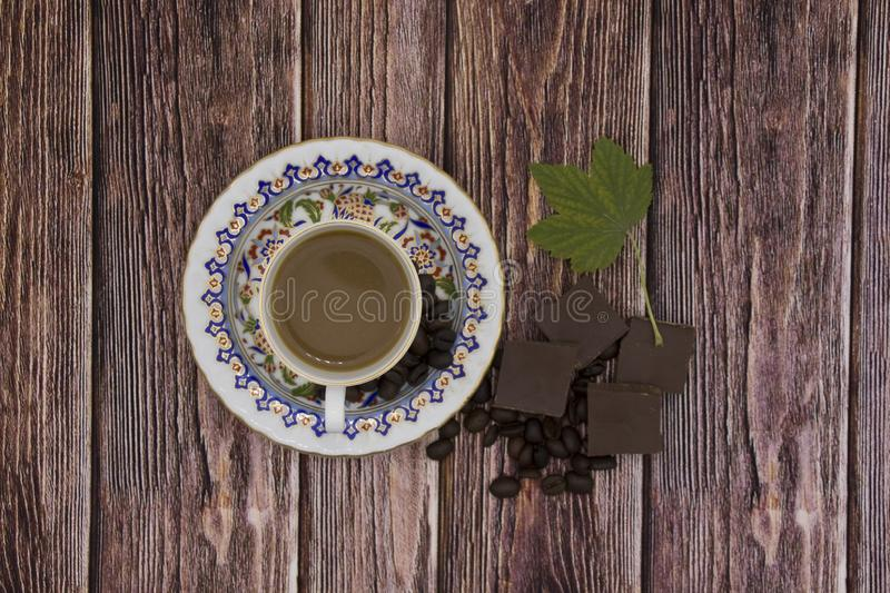Coffee cup espresso and poured milk or cream on old retro dark background with beans. Top view. Breakfast coffee love concept. Coffee cup espresso and poured royalty free stock photography