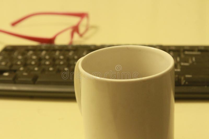 AT WORK COFFEE AND NO PLAY royalty free stock photo