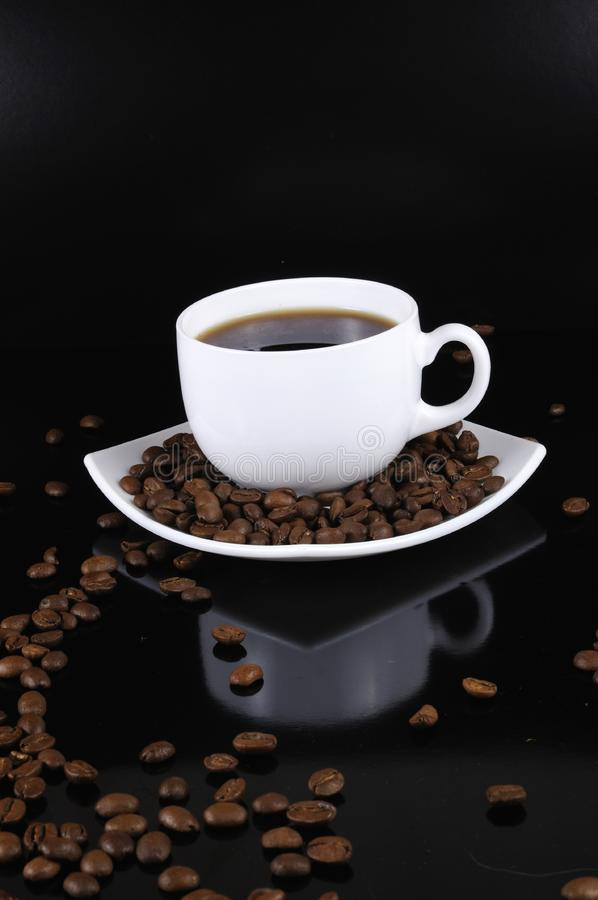 Coffee cup with highlited coffee beans stock image