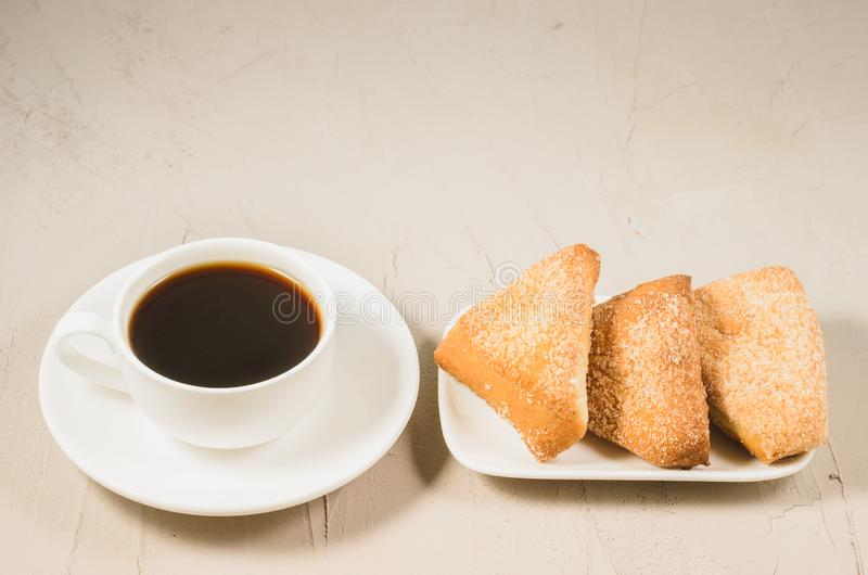 Coffee cup and homemade cookies/coffee cup and homemade cookies on a white stone background stock photography