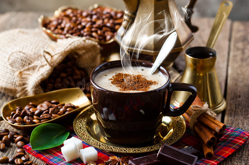 Coffee. Cup of hot drink with coffee beam's royalty free stock photography