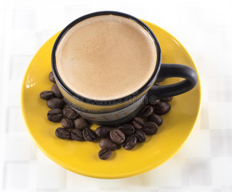 Coffee cup. Image of coffe cup from above, yellow saucer stock photo