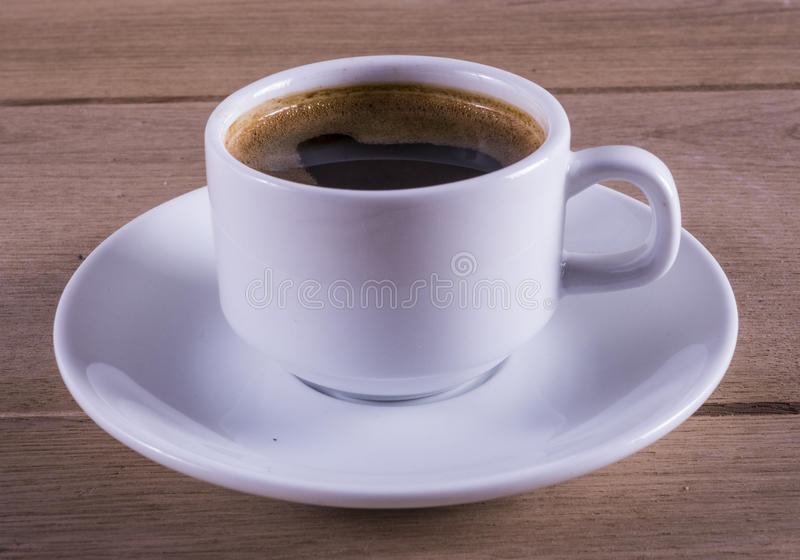 Coffee cup. Image of white cup of coffee on wood backgraund macro stock photography
