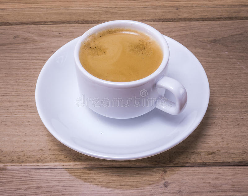 Coffee cup. Image of white cup of coffee on wood backgraund macro stock photos