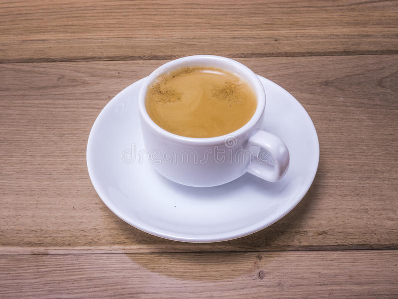 Coffee cup. Image of white cup of coffee on wood backgraund macro stock image