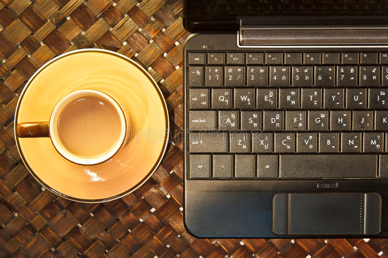Coffee cup with laptop. Above view stock images