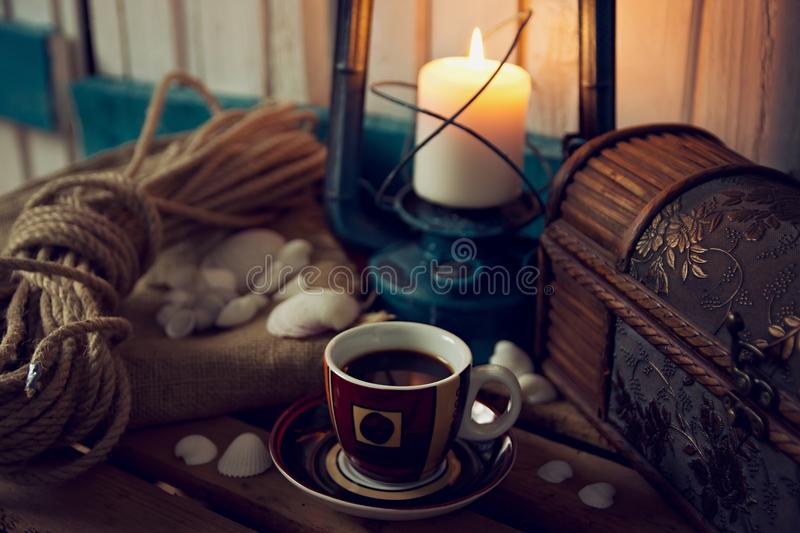 Coffee Cup with Marine Still Life Elements. Like Shells and Candle royalty free stock photography