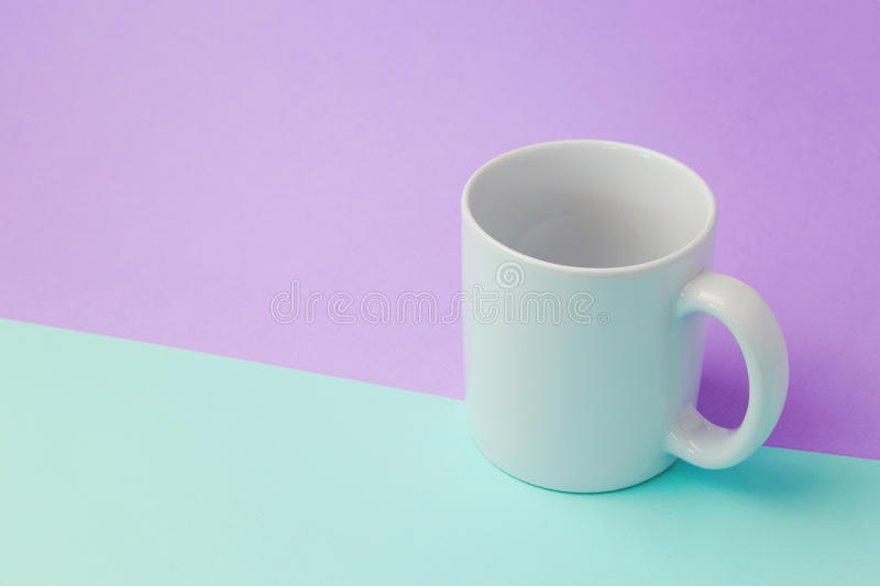 Coffee cup mock up template for logo design. Over retro color background stock photo