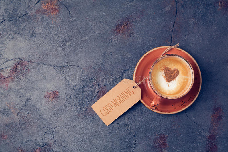 Coffee cup and note good morning on dark background. royalty free stock photos