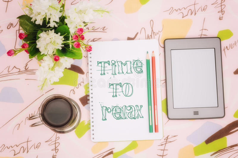 Coffee cup, notebook and ebook royalty free stock photography