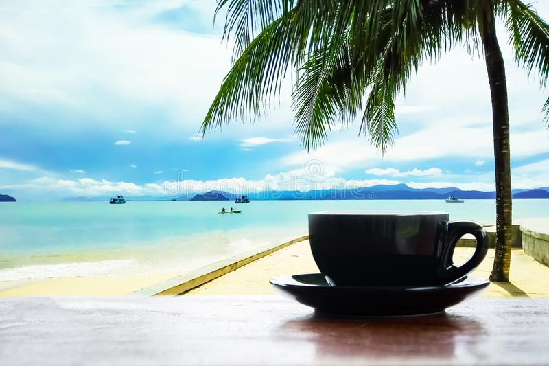 Coffee cup on old wooden table with nature background. royalty free stock photo