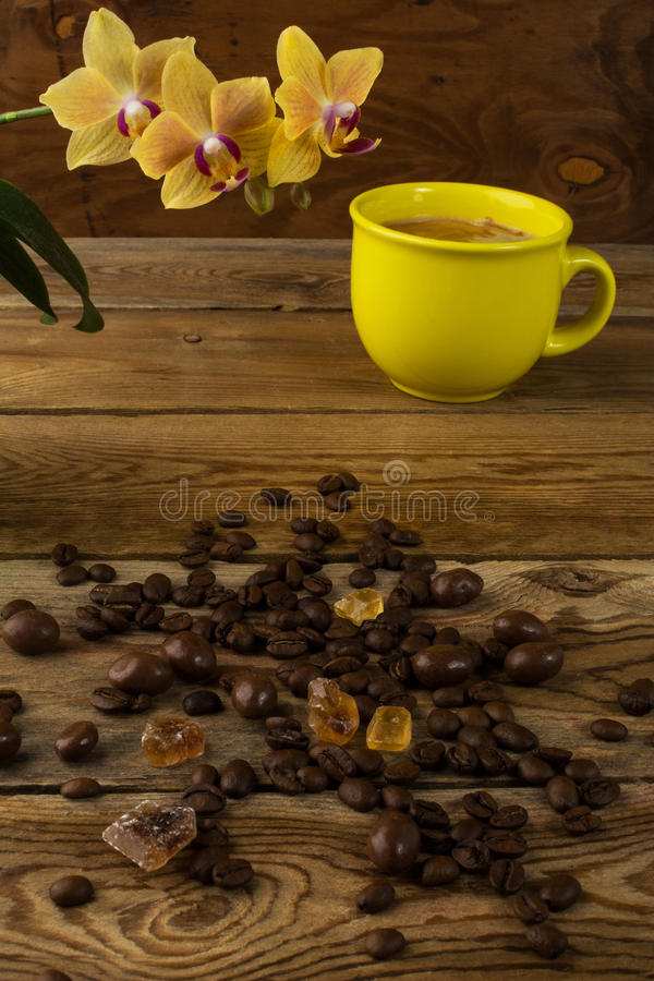 Coffee cup and orchid, vertical stock photography