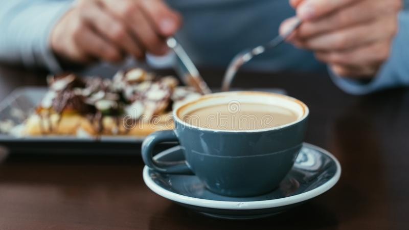Coffee cup pastry food habits traditional drink. Coffee in a cup and pastry. food habits. traditional drink and dessert royalty free stock image