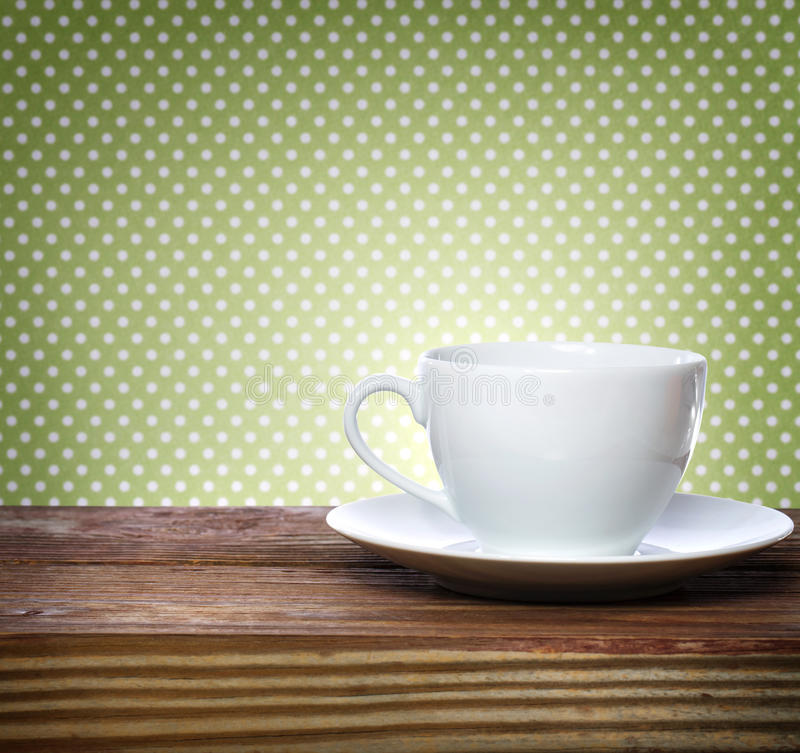 Coffee cup on polkadots background stock photo