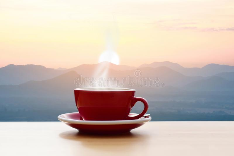 Coffee cup red with morning sunshine mountain. View stock images