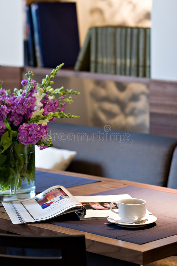 Coffee cup on restaurant table royalty free stock photos