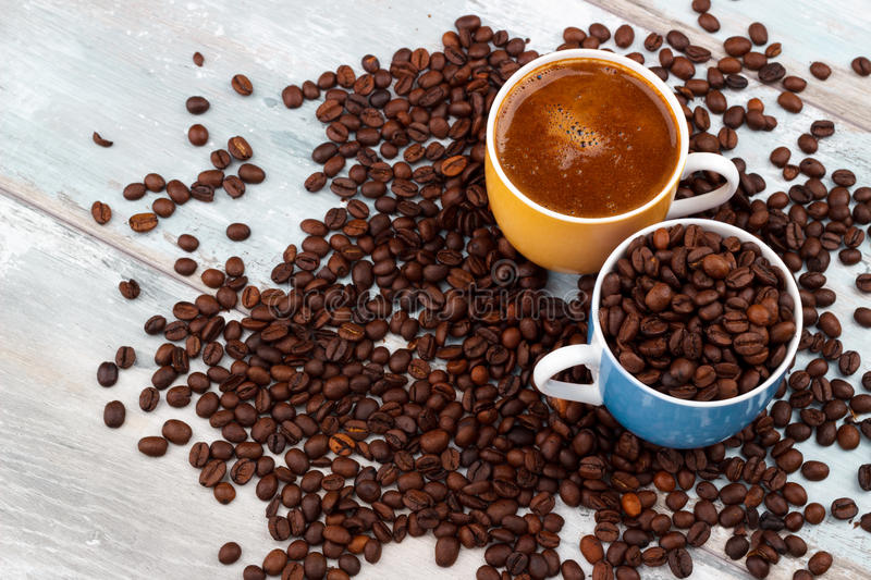 Coffee cup with roasted beans stock photography