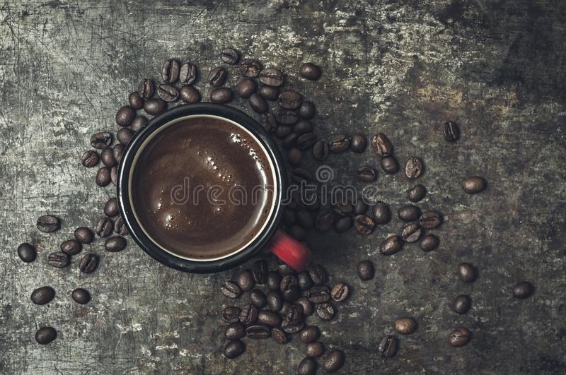 Coffee cup with roasted beans on stone background. royalty free stock photo