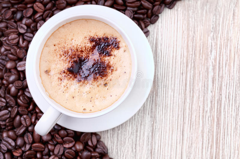 Coffee cup with roasted coffee beans stock photography